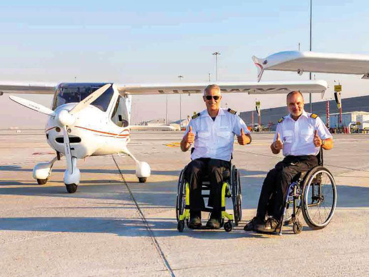 Two pilots in wheelchairs create history in UAE